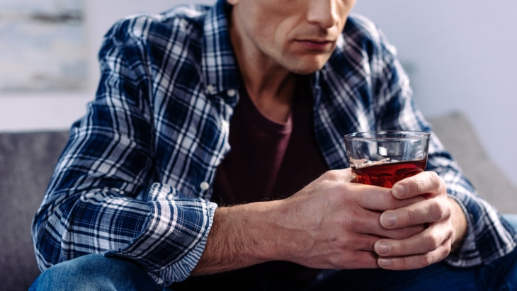 6 Ways to Know You Have a Drinking Problem North Jersey Recovery Center - A man is thinking about the red flags that may mean a drinking problem is prevalent and he may need treatment for alcohol addiction