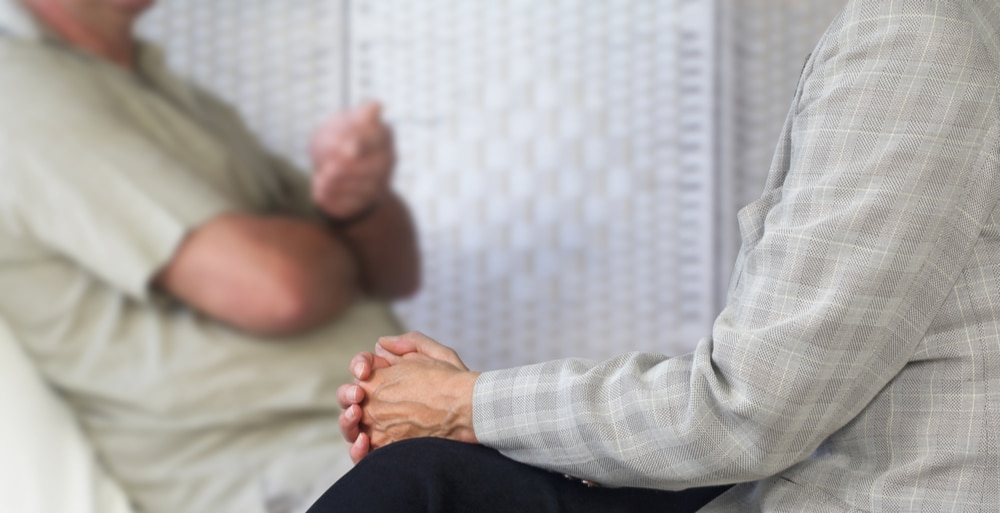 Integrated Treatment North Jersey Recovery Center - A man sits with a professional counselor at a rehab center to determine whether he has a dual diagnosis and requires integrated treatment during an initial assessment