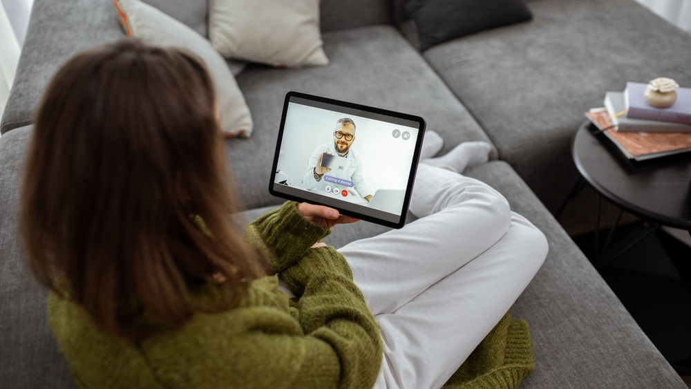Intensive Outpatient Program for Alcohol North Jersey Recovery Center - A woman is participating in an intensive outpatient program where she is holding a one-on-one, virtual session with a professional rehab facilitator for her addiction treatment