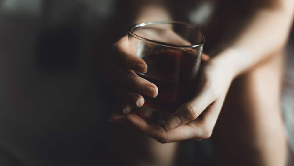 Is Alcohol a Drug North Jersey Recovery Center - A woman is struggling with her dependence on alcohol because is alcohol a drug? She is debating seeking treatment for her alcohol addiction