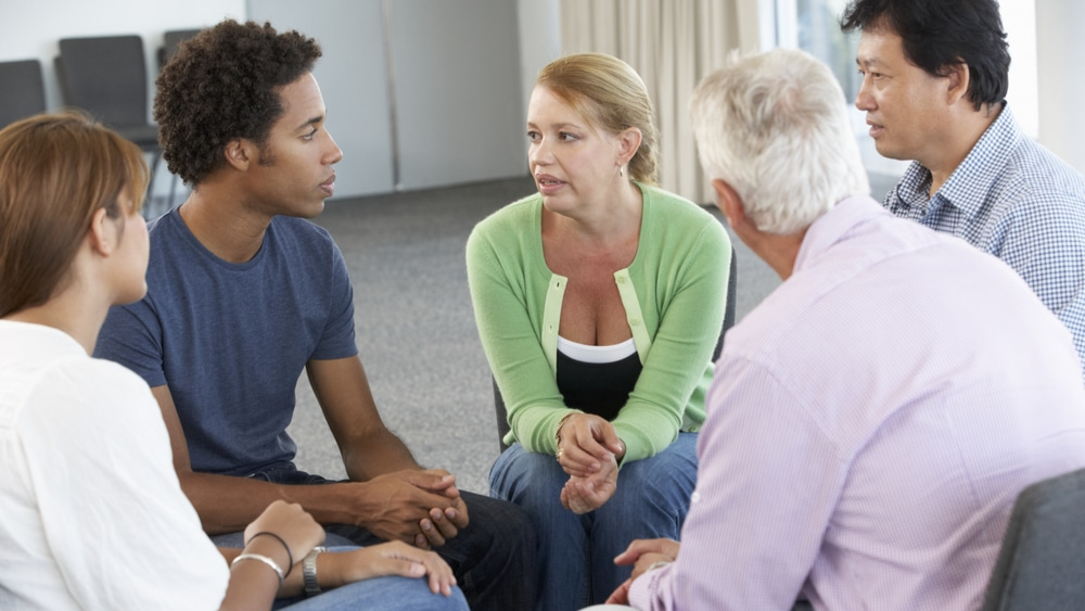 Evening IOP for Alcohol Rehab North Jersey Recovery Center - A group of individuals in recovery for alcoholism attends a support group therapy session as part of their evening IOP for alcohol rehab treatment.