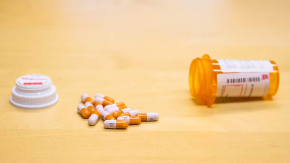 Adderall Addiction and Abuse North Jersey Recovery Center - An image of an Adderall prescription bottle with pills spilling out of it that can often lead to Adderall addiction if not taken directly as prescribed.